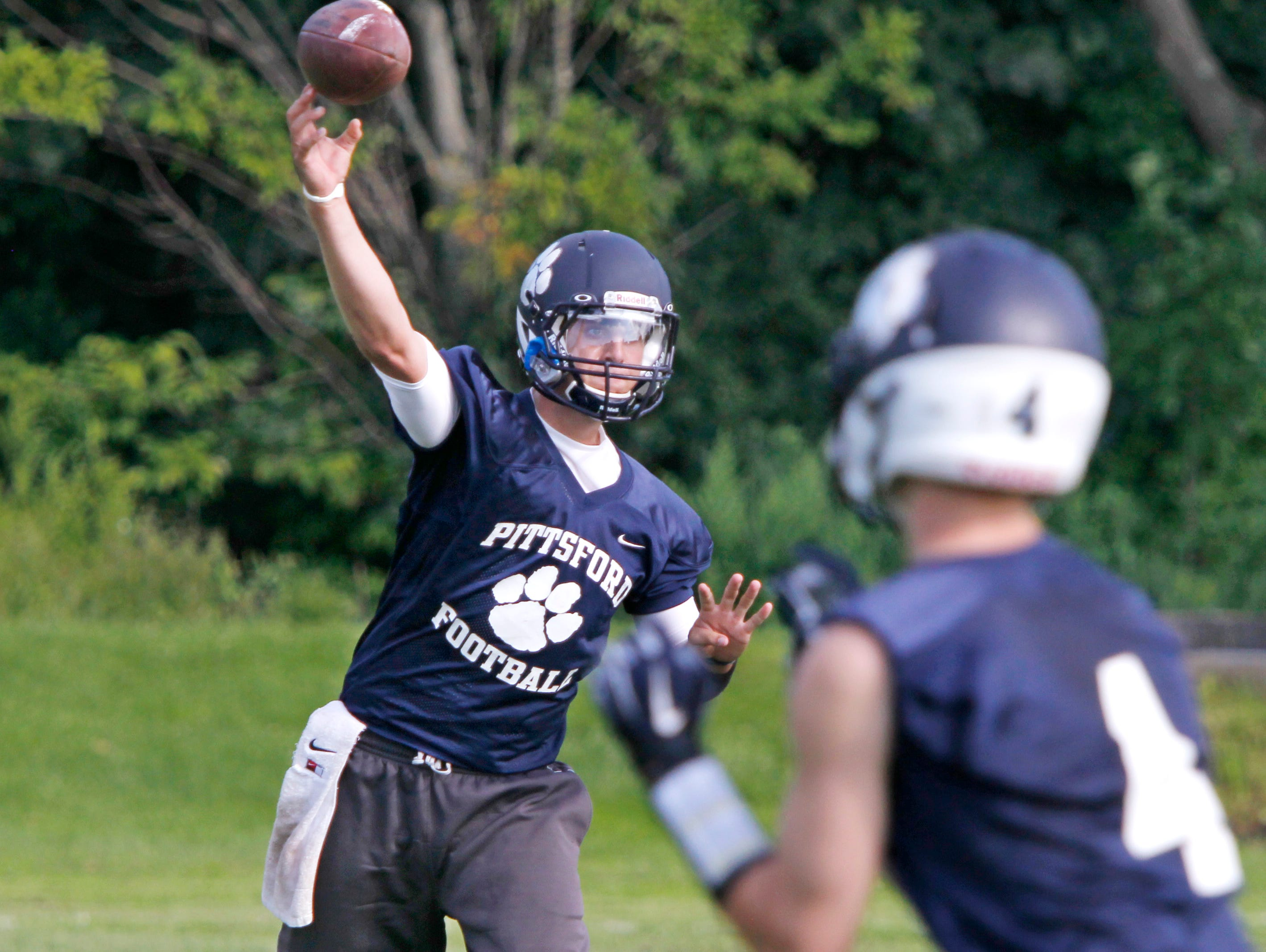 Pittsford quarterback Jack Wallman passes during offensive drills during practice on Tuesday.