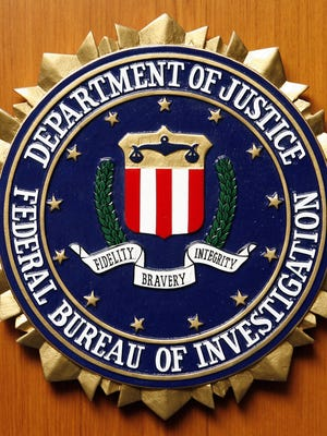 The FBI says a wanted man suspected of embezzling $8.7 million from a Cincinnati company has been  arrested six years after he was charged in a 75-count federal indictment.