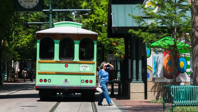 April 19, 2017 - A trolley bus travels north on S. Main St. on Main Street Mall on Wednesday afternoon. The Memphis Area Transit Authority will pull its trolley buses from Main Street Mall starting May 8 to prepare the mall for the eventual return of electric trolleys.