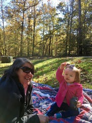 Barbara Guidry plays with granddaughter Marie on a blanket at Jimmie Davis State Park in Chatham.