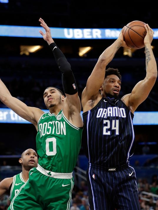 Orlando Magic's Khem Birch (24) grabs a rebound away from Boston Celtics' Jayson Tatum (0) during the first half of an NBA basketball game Friday, March 16, 2018, in Orlando, Fla. (AP Photo/John Raoux)