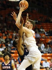 UTEP center Matt Willms draws a foul from UTSA's Kendell Ramlal while taking a shot Saturday night in the Don Haskins Center.