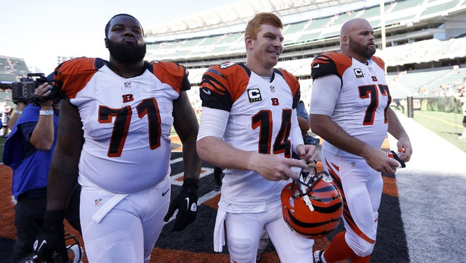Cincinnati Bengals quarterback Andy Dalton (14), tackle Andre Smith (71) and tackle Andrew Whitworth (77) at Paul Brown Stadium.