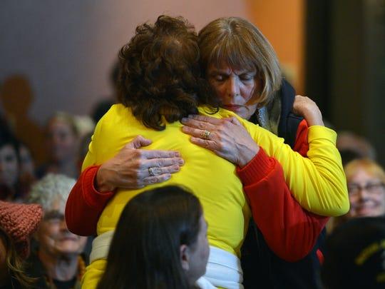 Republican Deborah Baber Savalla receives a hug of support at Democratic Congresswoman Julia Brownley's February town hall in Camarillo.