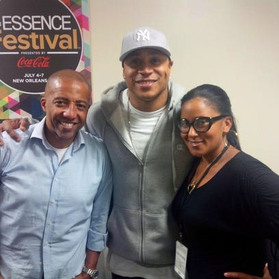 Amber Noble Garland stands with LL Cool J, one of the