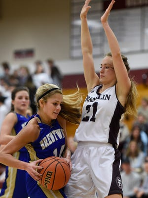 Brentwood's Izzy Franco (14) is stopped in the lane by Franklin's Abby Unger (21) during their game at Franklin High School Tuesday Feb. 7, 2017, in Franklin , Tenn.