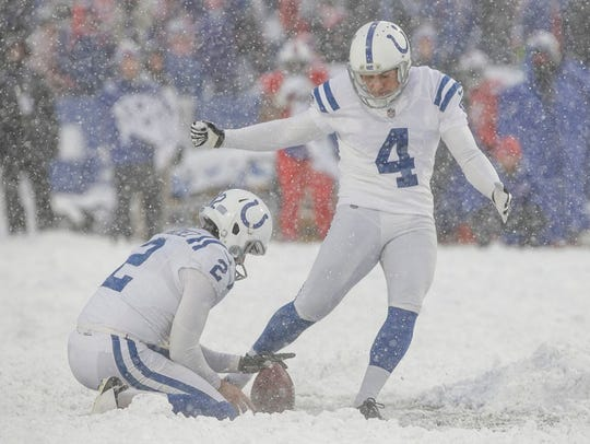 Indianapolis kicker Adam Vinatieri connects on a game-tying