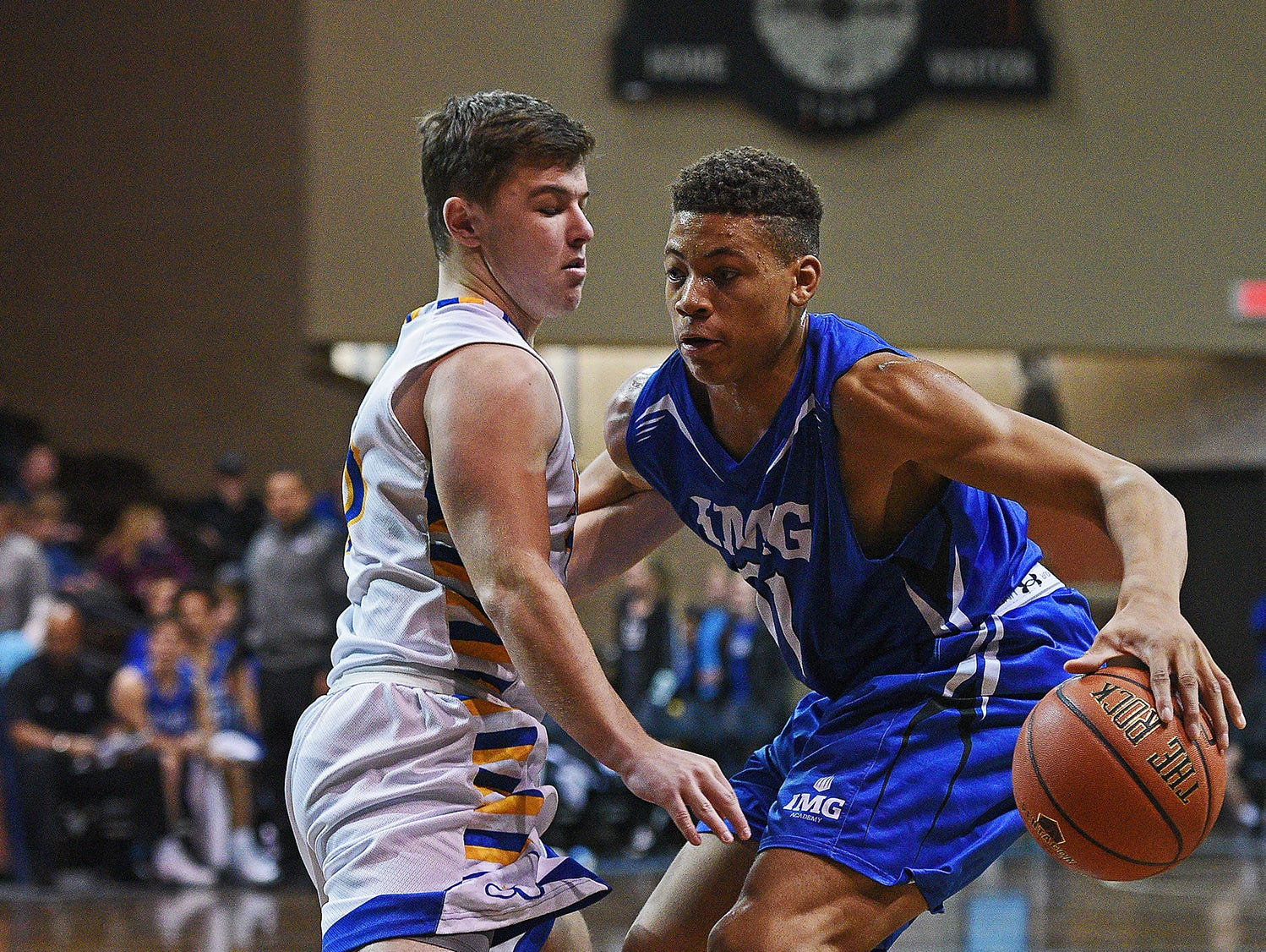IMG Academy's Keyontae Johnson (11) tries to get past O'Gorman's Riley Katen (10) during the Gary Munsen Tournament Championship game Friday, Dec. 30, 2016, at the Sanford Pentagon in Sioux Falls.