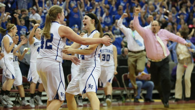 Newell-Fonda players Maddi Morenz, right, and Hailey Falline, left, celebrate after defeating Springville during the Iowa High School girl's Class 1-A championship game on Friday, March 6, 2015 at Wells Fargo Arena in Des Moines, Iowa.