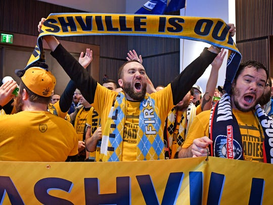 Fans celebrate as Major League Soccer officials name Nashville as a new MLS expansion city on Dec. 20, 2017.