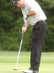 Bruce Lietzke follows a putt during the 2003 Emerald Coast Classic at the former Moors Golf Club located near Milton.