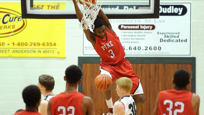Pike's Kendall Rollins dunks the ball against Pendleton Heights, Thursday, January 2, 2014, in Pendleton.
