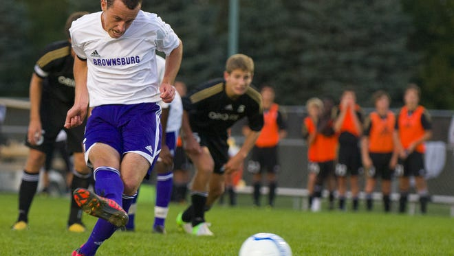 Brownsburg High School's Jack Griffith fires a penalty kick into the goal in a 2012 sectional game. He is an early enrollee at IU.