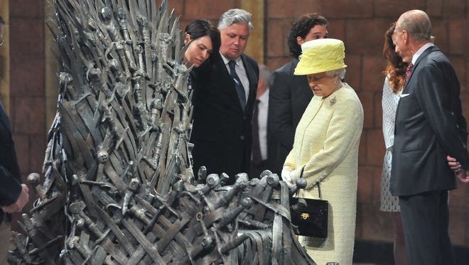 Britain's Queen Elizabeth, centre right visits the throne room at the set of the Game of Thrones TV series in  Titanic Quarter, in Belfast Northern Ireland,Tuesday, June, 24, 2014. The Queen is on a 3 day visit to Northern Ireland.