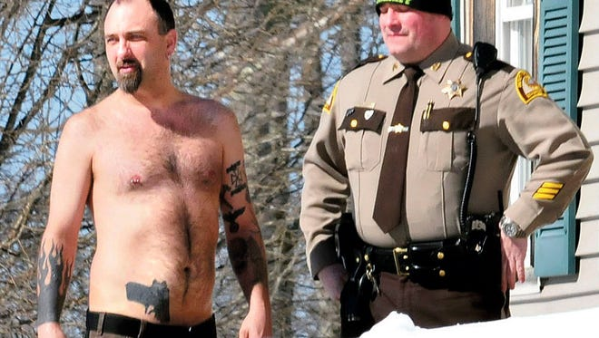 Tree trimmers mistook Michael Smith's realistic pistol-in-the-waistband tattoo for a real gun March 18, 2014, prompting police to briefly surround his home in Norridgewock, Maine.
