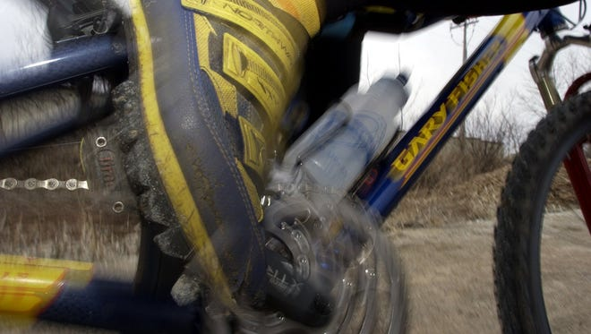 The man died in one of the Ore to Shore mountain bike races in Marquette, Mich.