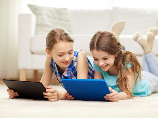 Children use computers at home.