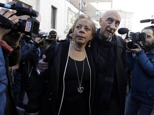 Sex abuse survivors, Denise Buchanan and Peter Isely, both founding members of the ECA (Ending Clergy Abuse), make their way through a crowd of journalists on the occasion of their meeting with organizers of the summit on preventing sexual abuse at the Vatican, Feb. 20, 2019.