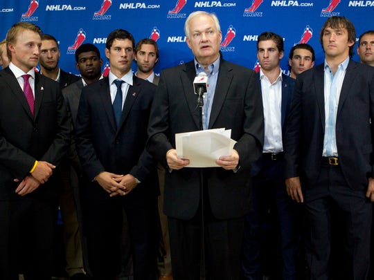 """Donald Fehr, center, shown here in 2012 with NHL players including Steven Stamkos, left, Sidney Crosby, second from left and Alex Ovechkin, right,  says """"We have been having discussions with the league about an extension of the CBA and expect that those talks will continue."""""""
