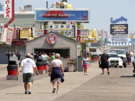 People walk on the Seaside Heights boardwalk Wednesday.