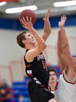 Derek Thompson of Rocori puts up a shot against an Orono defender  during the Friday, Dec. 30, game at St. Cloud Apollo High School.