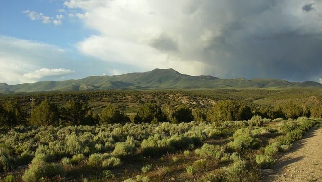A storm rolls over Diamond Peak in Eureka County in 2010. Environmental groups and ranchers are worried a proposed mine could lower the water table in Diamond Valley. The Bureau of Land Management is defending its permitting of the mine in Federal Circuit Court in San Francisco.