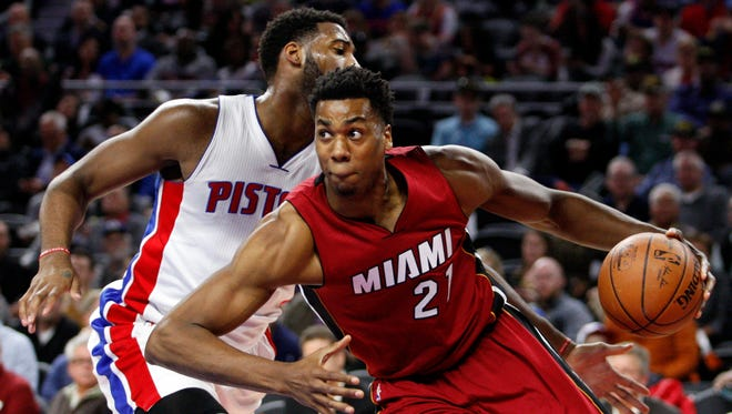 Miami Heat center Hassan Whiteside (21) is defended by Detroit Pistons center Andre Drummond (0) during the first quarter at The Palace of Auburn Hills last season.