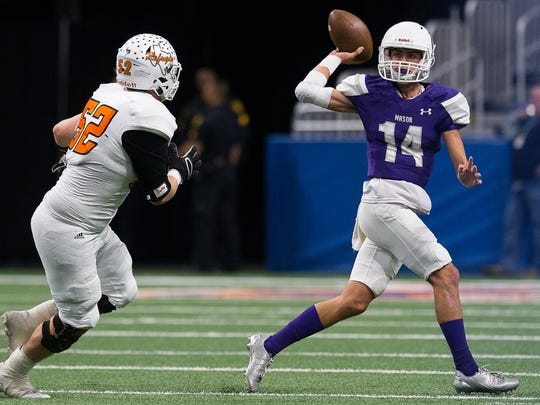 Refugio's Trey Upton puts pressure on Mason quarterback Otto Wofford during their Class 2A Division I state quarterfinal at the Alamodome in San Antonio on Friday, Dec. 8, 2017.