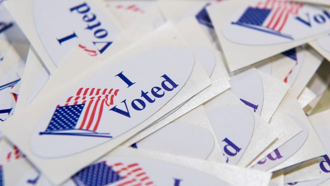 """""""I Voted"""" stickers are stacked on a table near the ballot box at the Cedar City Office Tuesday, June 26, 2018."""