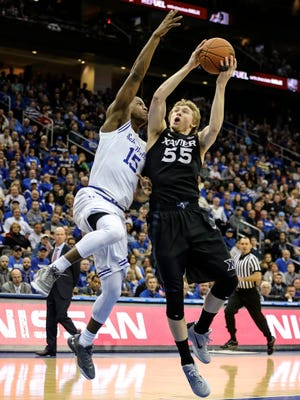 Xavier Musketeers guard J.P. Macura (55) tries to drive against Seton Hall Pirates guard Isaiah Whitehead.