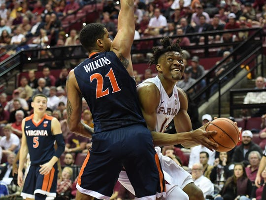 FSU freshman center Ike Obiagu (12) fighting down low on offense on Wednesday night at the Tucker Center.