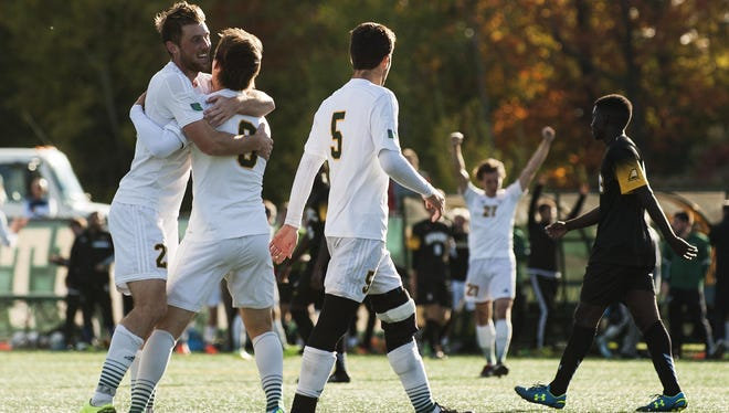 Vermont celebrates a goal during the men's soccer game between the UMBC Retrievers and the Vermont Catamounts at Virtue Field on Wednesday afternoon October 14, 2015 in Burlington.