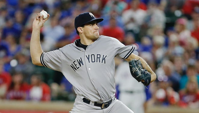 Yankees starting pitcher Nathan Eovaldi throws a splitter during the seventh inning against the Texas Rangers on April 25.