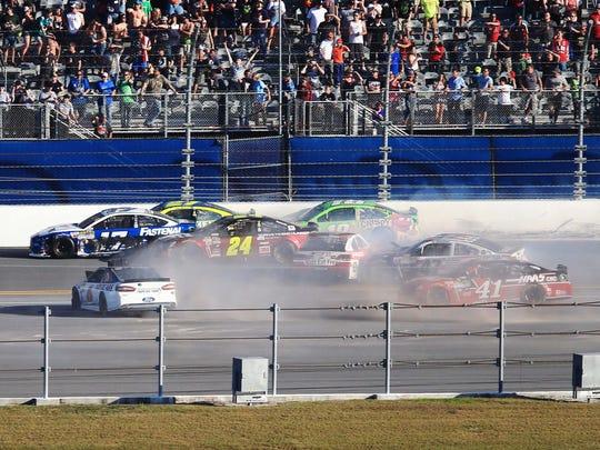 NASCAR Sprint Cup Series drivers Rick Stenhouse Jr. (17), Jeff Gordon (24), Paul Menard (27), Matt Crafton (18), Ron Hornaday (30) and A.J. Allmendinger (47) wreck during the Daytona 500 at Daytona International Speedway.