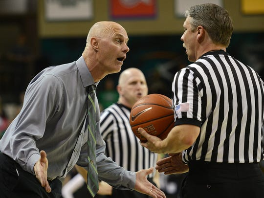UWGB head coach Kevin Borseth argues a call with the officials against UW-Milwaukee at the Kress Center March 11, 2015.