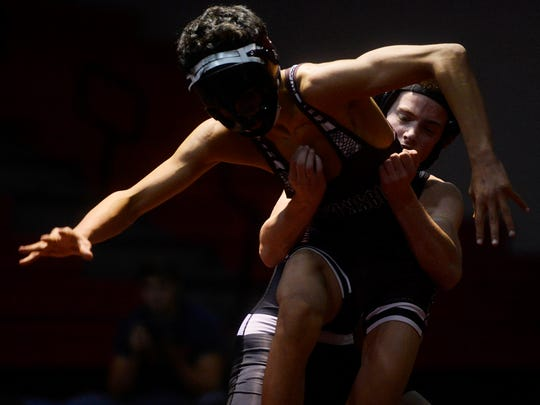 Susquehannock's Mike Younkin pulls down Gettysburg's Jacob Evans during a wrestling match at Susquehannock High School on Wednesday.