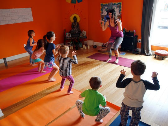 Alice Balzarini leads her students during the yoga class for kids at Coba Yoga in Little Silver.