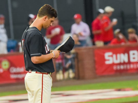 Starting pitcher  Gunner Lege takes a moment before going to work in the first inning as the Cajuns take on the Warhawks from ULM at Tigue Moore Field.