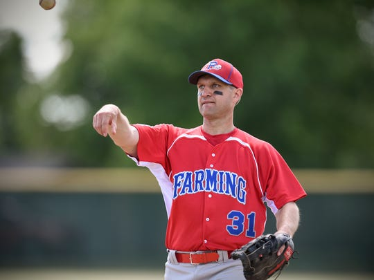 The Rev. Aaron Nett tosses a ball back to the dugout during a game Sunday, July 3, 2016, in Richmond between the Farming Flames and the Richmond Royals.