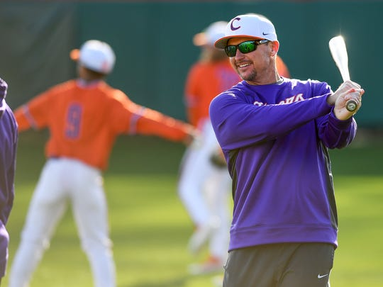Clemson head coach Monte Lee warms up before hitting infield during the Tigers first practice of the season at Doug Kingsmore Stadium on Friday, January 27, 2017.