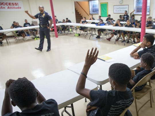 IMPD Sgt. Michael Wolley speaks during a meeting of Young Men, Inc., youth ministries, Indianapolis, Tuesday, July 11, 2017. Wolley had been helping mentor the program in plain clothes, and came today in uniform to show the kids that police officers should be thought of as regular people.