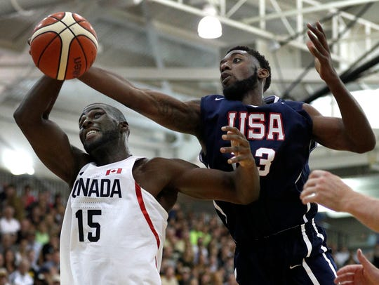 Team USA's Jacquil Taylor (23) pulls in rebound over
