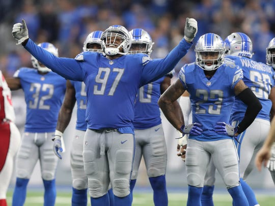 Akeem Spence celebrates a fourth-quarter stop against the Cardinals in the Lions' 35-23 win Sunday, Sept. 10, 2017 at Ford Field.