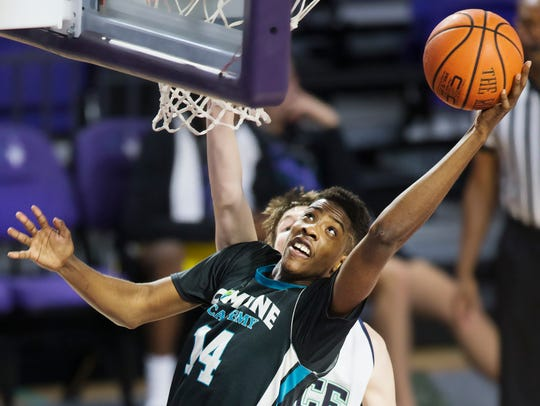 Combine Academy's Amari Haynes rebounds against the State College of Florida during the Florida SouthWestern State College basketball classic at Suncoast Credit Union Arena in south Fort Myers. Haynes is a Mariner High School graduate.