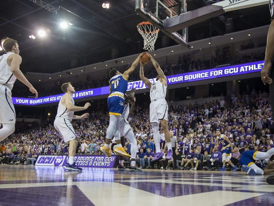 Tulare's Keonta Vernon (24) of the Grand Canyon Antelopes grabs a rebound against Justin Mccall (11) of the Cal State Bakersfield Roadrunners at Grand Canyon University on Saturday, March 3, 2018 in Phoenix, Arizona.