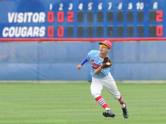 Cooper center fielder Jared Rodriguez hauls in Jacob