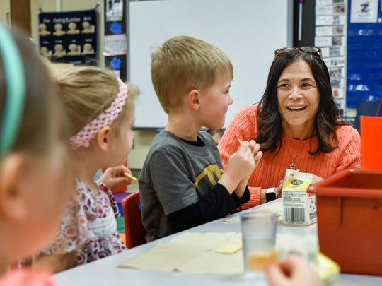 Minnesota Commissioner of Education Brenda Cassellius talks with preschool students Wednesday, April 25, during a visit to Westwood Elementary School in St. Cloud.