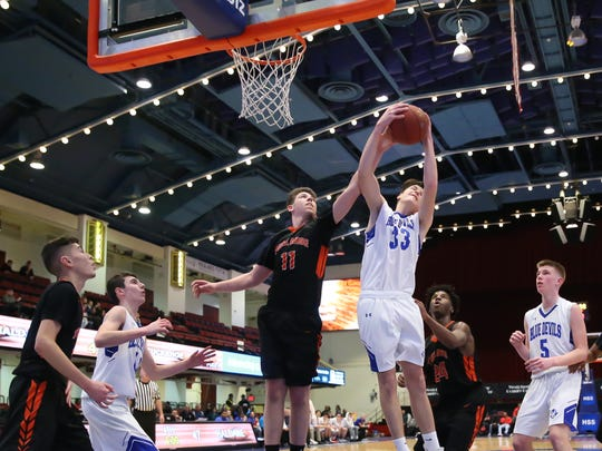Haldane's Liam Irwin (33) pulls a rebound from Tuckahoe's Jonathan Berger (11) during the boys basketball Class C semi-final basketball game at the Westchester County Center in White Plains on Tuesday, February 20, 2018.