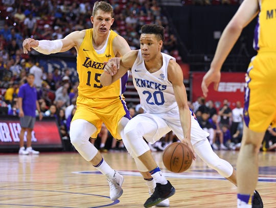 Knicks forward Kevin Knox (20) dribbles inside Lakers