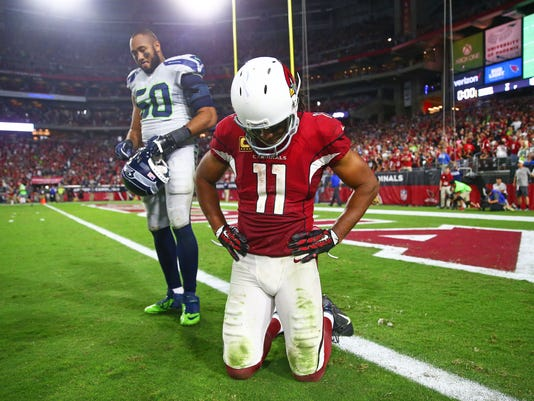K.J. Wright and Larry Fitzgerald